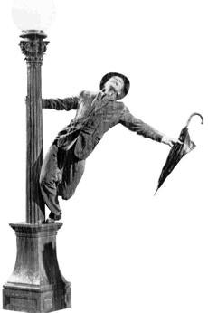 "Gene Kelly performs in the 1952 film ""Singin' in the Rain."""